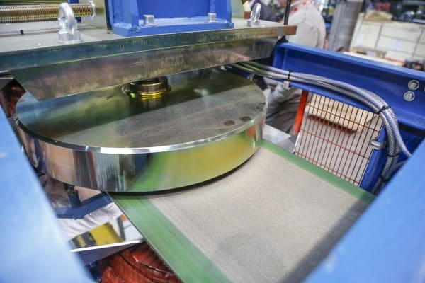 Magnetic Disc Separator across the conveyed mineral mix