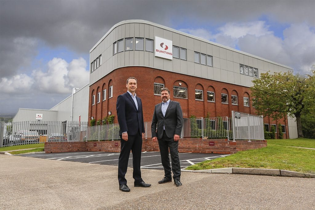 Simon Ayling and Adrian Coleman outside the new extended Bunting-Redditch manufacturing facility