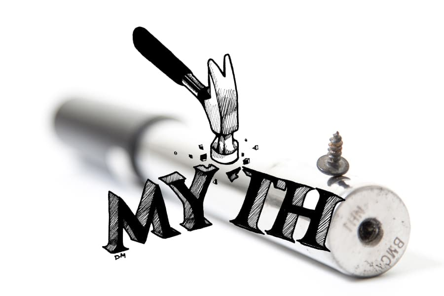 A hammer breaking up the word myth